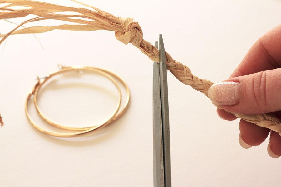 Raffia braided earrings step one- braid raffia and cut off the knot