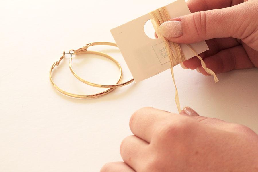 Raffia tassel earrings step one- wrap raffia around cardboard