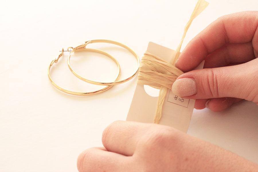 Raffia tassel earrings step two - slip a strand through the loop
