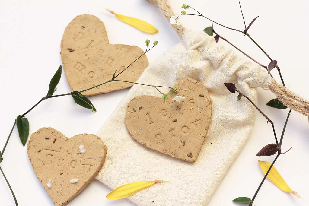 Make these seed-pressed clay hearts to gift a special someone flowers! | Dossier Blog