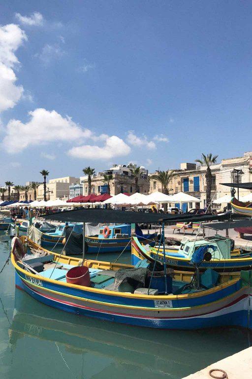 Colourful fishing boats in Marsaxlokk, Malta | Dossier Blog